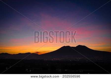 Sunrise casting the shadow of Mount Vesuvius over Naples Italy. Taken February 2 2006.