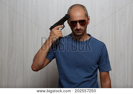 suicide simulation - A man with the gun at his head