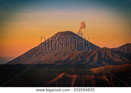 Mount Bromo volcano (Gunung Bromo) at sunrise with colorful sky background in Bromo Tengger Semeru National Park East Java Indonesia.