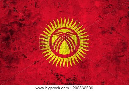 Flag of the Kyrgyzstan against the background of the stone texture