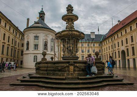 PRAGUE, CZECH REPUBLIC - AUGUST 16, 2017: Fountain in the castle of Prague, Bohemia