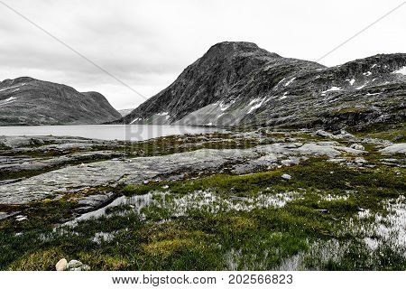 Landscape and snow covered mountains in western Norway with a lake