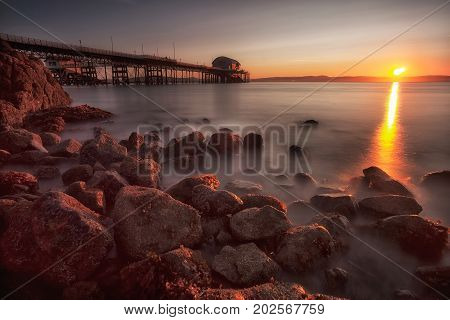 A calm morning at Mumbles Pier, showing the new lifeboat station, Swansea, South Wales, UK