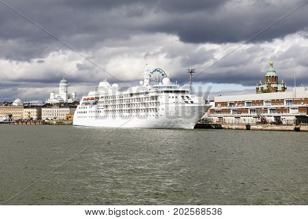 HELSINKI FINLAND - AUGUST 13 2017: Big white cruise ship in city harbor of Helsinki Finland on August 13 2017