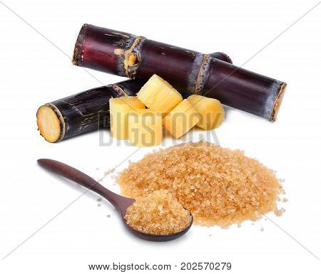 brown cane sugar in wooden spoon with fresh sugarcane isolated on white