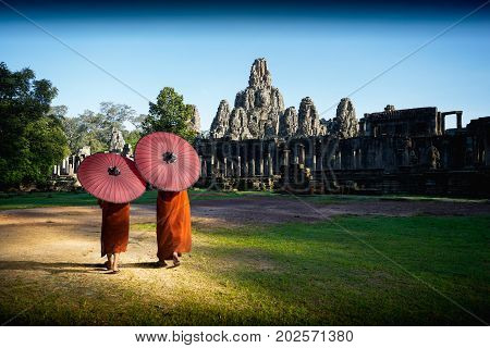 Ancient stone faces of Bayon temple Angkor wat Siam Reap Cambodia