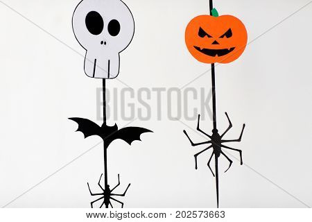 holidays and decoration concept - halloween paper party garlands over white background