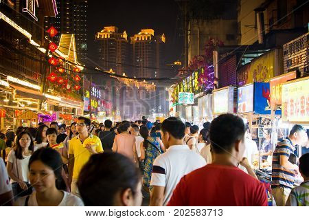 Nanning, China - June 9, 2017: Nanning Zhongshan Snack Street With Many People Bying Food And Walkin
