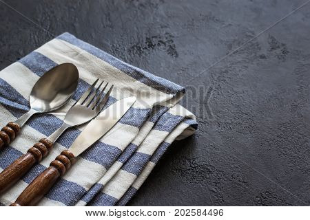Food cooking background. Careless simple table setting. Set of cutlery with wooden handles