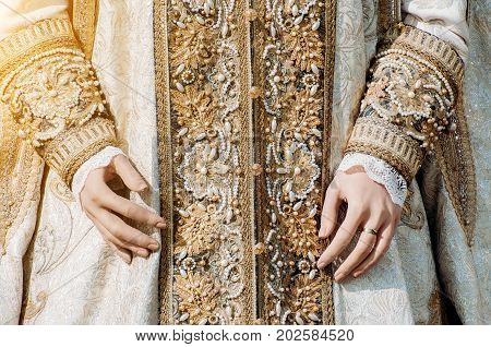 Clothes Of A Historical Imperial Woman With Pastel Tones, Hands With A Ring With A Precious Stone