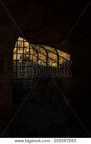 Sunlight through the dungeon bars at Kalemegdan fortress, Belgrade, Serbia