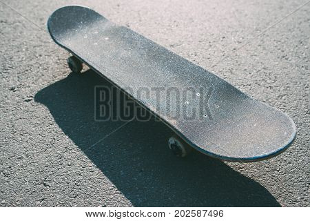 One skateboard on the road. Extreme sport challenge and skateboarder competition, ready to adventure, close up picture