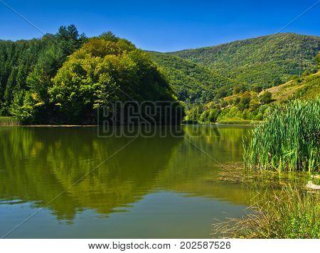 Lake at morning sunshine in Semenic national park, Banat region, west Romania