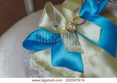 Gold wedding rings on the pincushion. Wedding Pic.
