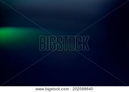 Abstract background of blurred green light blur. Bokeh of defocused lines in motion, aurora skylights wallpaper, magic of nature around