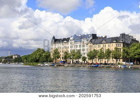 Large residential building with small harbor at river side in Helsinki Finland
