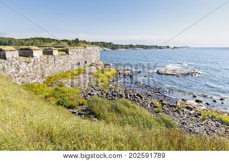 Mighty stone walls of Suomenlinna fortress in Helsinki Finland in summer