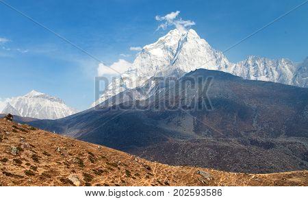 Evening view of mount Ama Dablam on the way to Mount Everest Base Camp Khumbu valley Solukhumbu Sagarmatha national park - Nepalese himalayas mountains