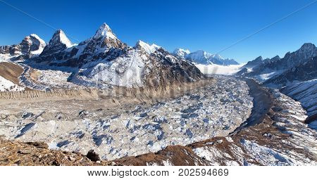 View of mount Cholo Kangchung peak and Nirekha peak and Ngozumba glacier way to Cho Oyu base camp Gokyo valley Sagarmatha national park Khumbu valley Nepalese Himalayas