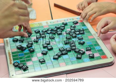 CHONBURI THAILAND - AUGUST 28 2017: Student playing scrabble cross word in school.
