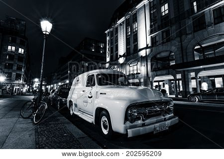 BERLIN GERMANY - OCTOBER 13 2015: Full-size pickup truck Ford F100 Panel Van 1953 (second generation) on the night street. Black and white. Ford F-Series - is a popular American pickup.