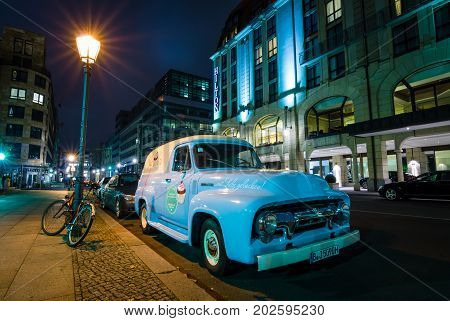 BERLIN GERMANY - OCTOBER 13 2015: Full-size pickup truck Ford F100 Panel Van 1953 (second generation) on the night street. Ford F-Series - is a popular American pickup.