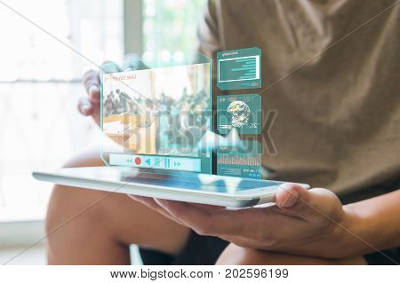 Man or Male use Digital Wireless Touch Screen Tablet Device with LIve Video Streaming Tele conference Meeting and Analyze Stock Data Weather forecast Navigation system and Investment as Modern Lifestyle Technology Concept.
