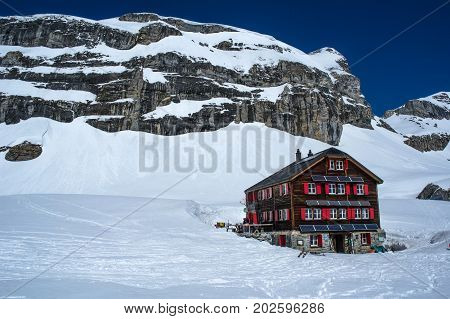 view of lammerenhutte in swiss alps during winter