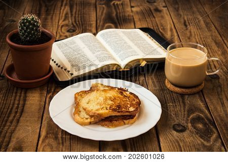Bible and coffee French toasts cactus breakfast wooden background