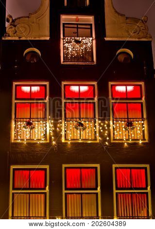 Building lighted with red in the red light district  Amsterdam