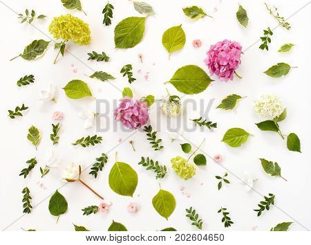 Floral Pattern Made Of Blooming Flowers And Leaves. Creative Arrangement For Holiday Greeting Card.