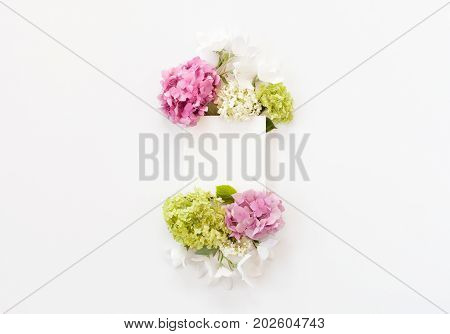White Fabric Mock-up With Blooming Flowers And Leaves. Flat Lay, Top View