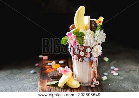 Fresh Tasty Cocktail With Berries, Sweets And Flowers