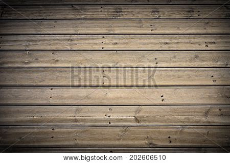 Close-up of a natural Wooden Texture with vignetting. View on a wood plates with vignetting. Natural Backgrounds.
