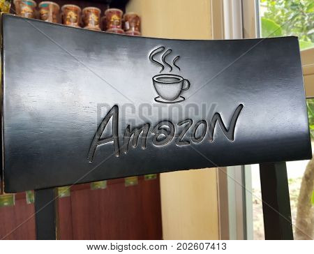 Pathum Thani THAILAND - Sep 32017 : Close up a Amazon logo screened on the chair at Cafe Amazon coffee shop. It's a famous Thai franchise coffee house in Thailand.
