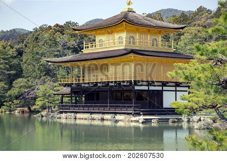 JAPAN, KYOTO, APRIL, 06, 2017 - Kinkaku-ji Temple or Golden Pavilion, is one of Japan`s most famous temples. World Heritage listed, and it is truly unique in Kyoto, Japan.