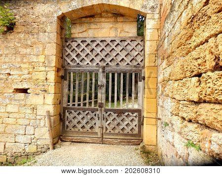 Medieval double doors, located at Chateau de Commarque, Dordogne, France