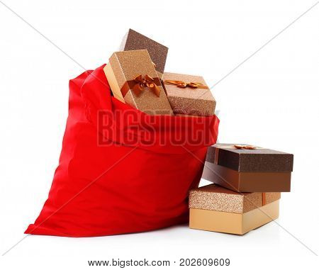 Big Santa Claus bag and giftboxes on white background