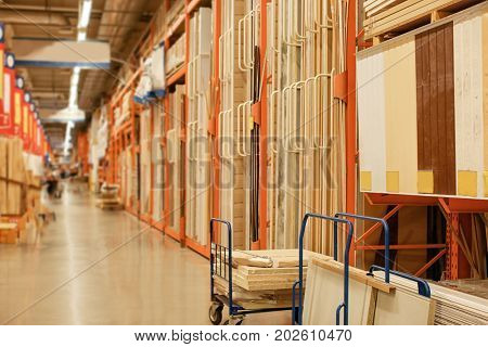 Aisle racks with wooden planks in storehouse