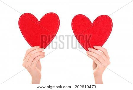 Woman holding red hearts on white background. Volunteer concept