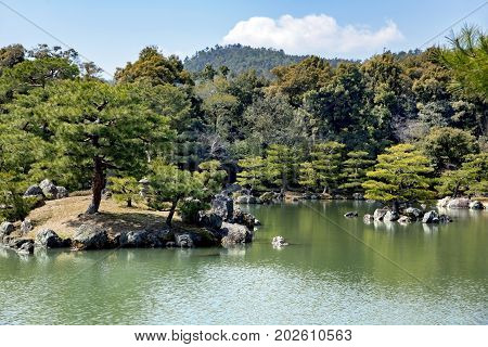 Kinkaku-ji Temple or Golden Pavilion, officially named Rokuon-ji is set in a magnificent Japanese strolling garden. The pond contains 10 smaller islands where a plants are arranged in a specific way to represent famous places. Kyoto. Japan.