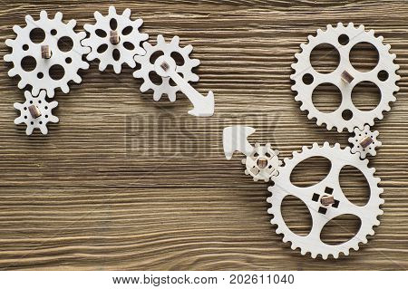 Gear wheels on wooden background. The concept of creative logical thinking. Logic background.