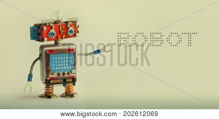 Robotic technology concept. IT specialist cyborg toy, smiley red head blue monitor body. Robot digital message on beige canvas. copy space photo.