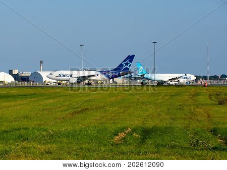 MONTREAL CANADA - AUGUST 28 2017 : Air Transat planes. Air Transat is a Canadian leisure airline based in Montreal Quebec operating scheduled and charter flights serving 63 destinations