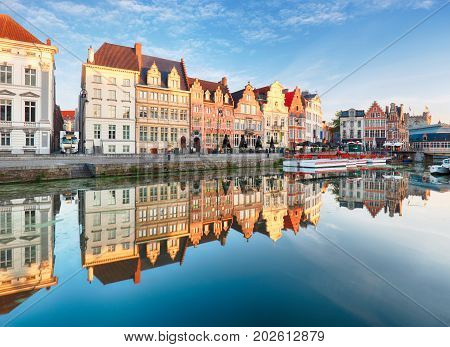 Gent Belgium. Sunrise in historical center of Ghent reflecting in water of river Leie Flanders Belgium.
