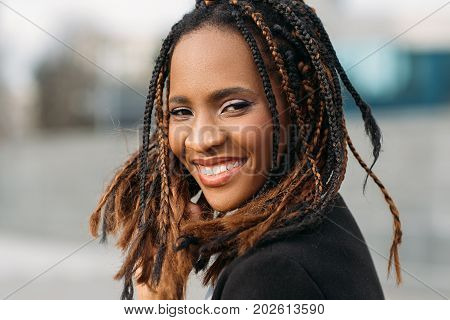 Happy young black woman smile. Joyful mood. Stylish smiling model, African American female in selective focus outdoors, happiness concept