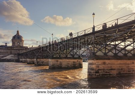 Institut de France and Pont des Arts (Passerelle des Arts) on sunset (before it was hung with locks of love). France. Paris.