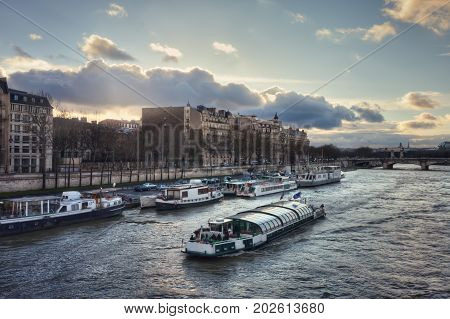 The Seine river and the quai Anatole France  at sunset. View from the Passerelle Leopold-Sedar-Senghor. France. Paris.