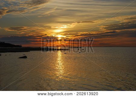 Colorful sunset by the coast at the swedish island Oland in the Baltic Sea