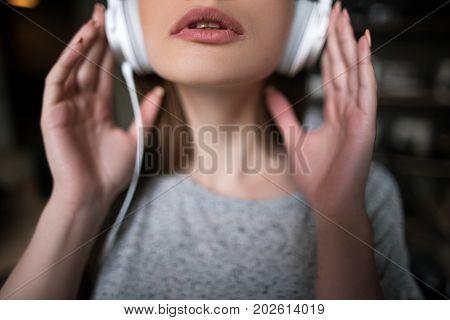 Seductive young female. Pleasure background. Sexual mood, unrecognizable woman enjoying music in headphones